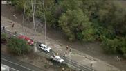 Спасител отнесен от силното течение на реката в Лос Анджелис !