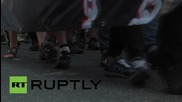 Ukraine: Nationalists march in support of suspected killers of Oles Buzina