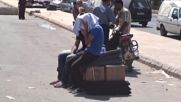Syria: Thousands displaced by fighting receive aid in Hama city