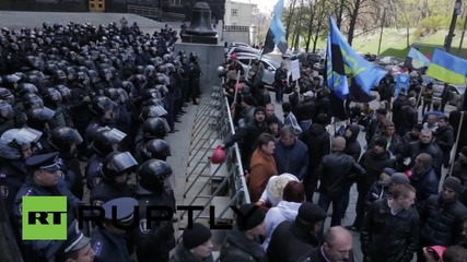 Ukraine: Miners face off with riot police outside Presidential Administration