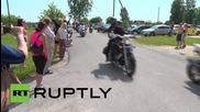 Estonia: Bikers ride to oppose refugee camp