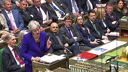 UK: May, Corbyn battle over Brexit plan at PMQs