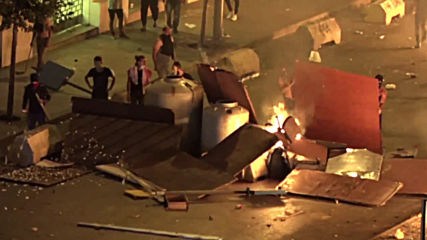 Lebanon: Clashes break out as protesters start fires in Beirut streets