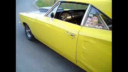 Yellow Dodge Coronet Burnout