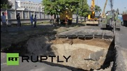 Ukraine: Massive sinkhole splits apart Kiev street