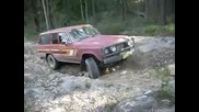 60 series landcruiser on rutted hill