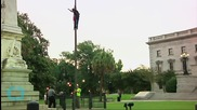Woman Removes Confederate Flag in Front of SC Statehouse