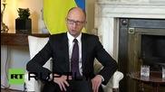 "UK: Yatsenyuk tells Greece to follow conflict-torn Ukraine's apparent ""success story"""