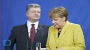 Obama, Merkel Reiterate no Easing of Sanctions on Russia