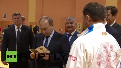 Russia: Putin visits Russia's weightlifters amid WADA's doping allegations