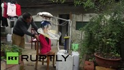 "China: Inventor presents ""hair-washing machine"" after years of experimentation"