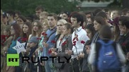 Russia: Moskva River bank aglow with candles on anniversary of war