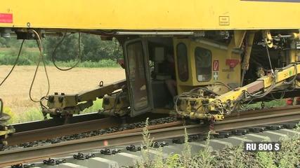 Монтиране на влакови релси