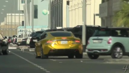Gold Aston Martin Dbs - Driving By
