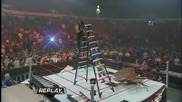 Edge throws The Undertaker off a Ladder throught four Tables