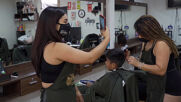 The Hooters of hair salons turns - and styles - heads in Lima