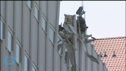 Material Being Lifted by Crane at NYC Building Falls