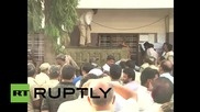 India: The moment leopard BITES careless official while trapped in school