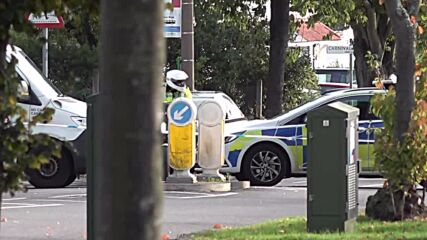 UK: Johnson leaves flowers at crime scene after Tory MP is killed
