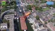 Twenty injured as Homes crushed by falling cranes in Holland