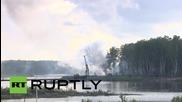 Russia: Amphibious units launch mock assault across lake amid gunfire