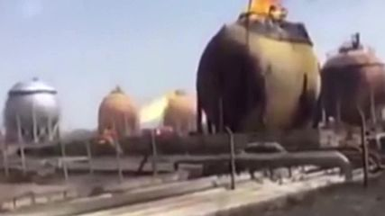 Iraq: Baghdad gas plant burns following deadly suicide attack