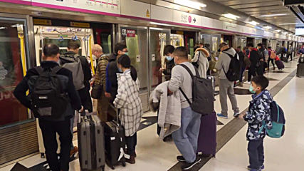 Hong Kong: Passengers from mainland China wear masks