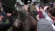 Chile: Police officer on motorbike hit with rock during Santiago clashes