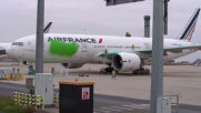 France: Activists paint plane green at Paris airport in protest over climate change response