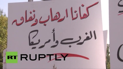 Syria: Shells hit near Damascus rally in support of Russian intervention