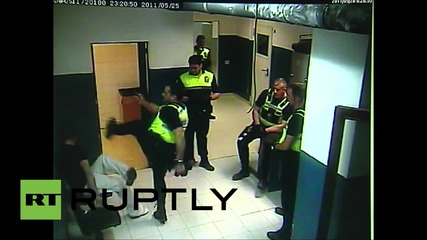 Spain: Police officer KARATE KICKS handcuffed man in Majorca police station