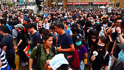 Hong Kong: Anti-government protesters flood downtown for 11th consecutive weekend