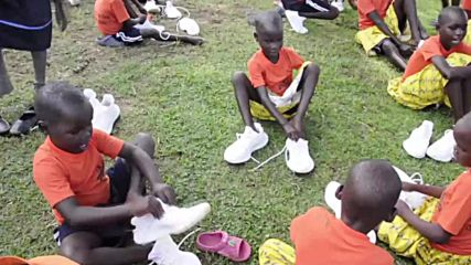 Get your kicks on! Kimye hand out free Yeezys to Ugandan schoolkids