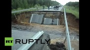 Russia: Road bridge collapses due to heavy rain in Tyumen