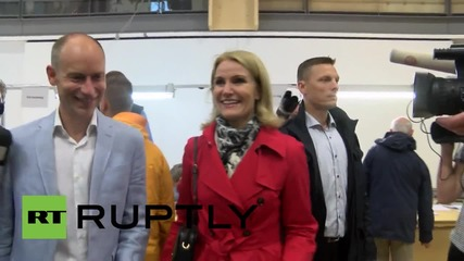 Denmark: Incumbent Prime Minister casts ballot as polls show voters split
