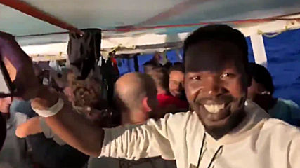 Italy: Migrants on board Open Arms celebrate news of allowed disembarkation