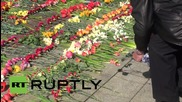Latvia: Thousands celebrate V-Day in Riga with floral tributes to Red Army