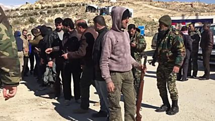 Syria: Surrendered militants hand in their weapons in Wadi Barada