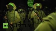 Тежковъоръжени бойци на Хамас минават по улиците на Газа
