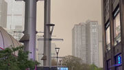China: Beijing sky singes orange as sandstorm dust blankets city