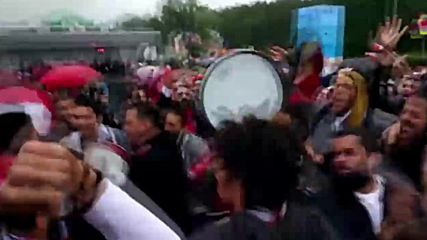 Singing in the rain! Egyptian fans in high spirits ahead of Russia clash