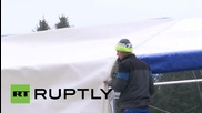 Austria: Refugees wait to cross into Germany as temperatures drop