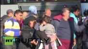 Croatia: Refugees struggle to board bus bound for Hungarian border