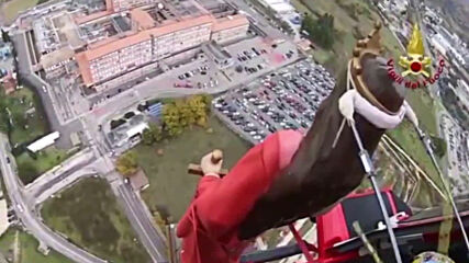 Italy: Saint Barbara statue flies over town in chopper as traditional procession curtailed by COVID