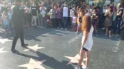 9 year old girl stops and dances w street performer Holywood Freestyle Dance Party Bass Film Menejer