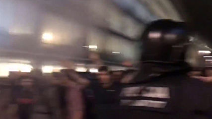 Spain: Police use batons and tear gas on protesters at Barcelona airport