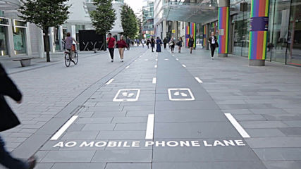 Manchester introduces pedestrian 'Slow Lane' to stop phone users from colliding