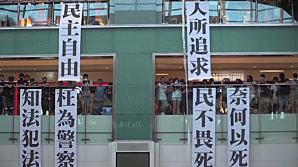 Hong Kong: 'Glory to Hong Kong' protest anthem echoes in shopping centre rally
