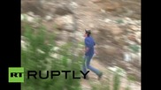 State of Palestine: Israelis throw rocks at Palestinians during day of violent clashes in Hebron