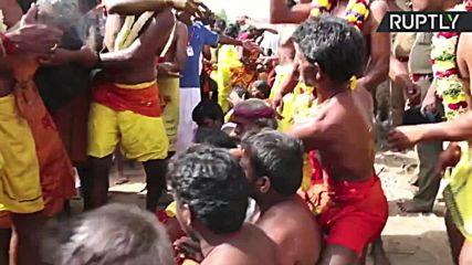 Coconuts Smashed On Heads of Devotees for Indian Ritual